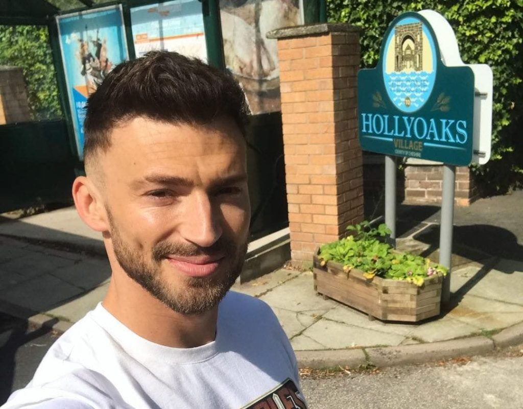 Jake Quickenden filming on the set of Hollyoaks